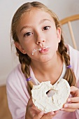 Portrait of girl (12-13) eating cake