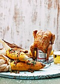 Beer can chicken and barbecued corn with chilli and parsley butter