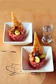 Beef tartar with mushrooms, pickles and triangular toast