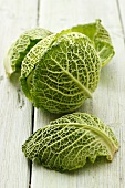Head of savoy cabbage and leaves