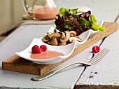 Green salad with pan fried mushrooms and raspberry dressing