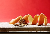 Still life with orange peel, cinnamon, star anise and powdered sugar