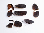 Slices of charred bread in front of white background