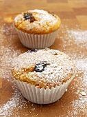 Olive muffins on a wooden surface