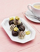 Olive pralines with a cup of coffee