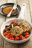 Pork chops with cherry tomatoes and olives