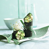 Spring rolls in nori leaves with avocado, cucumber and alfalfa sprouts