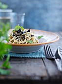Spaghetti with black olives and mint