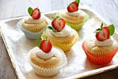 Vanilla cupcakes garnished with strawberries
