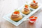 Mini-pizzas with salmon fillets and caviar