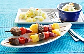 Barbecued pineapple kebabs and salad