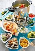 Fondue with fish and vegetables