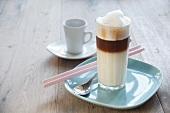 Non-dairy vanilla macchiato in a glass