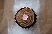 Chocolate cupcake with a sugar flower