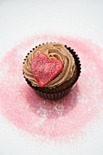 Red heart on a chocolate cupcake