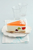 A slice of cheesecake with fruit jelly