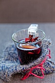 A glass of mulled wine with star anise