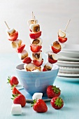 Marshmallow and strawberry skewers in bowl