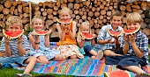 Germany, Bavaria, Group of children eating watermelon