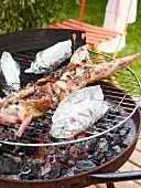 Grilled rabbit with thyme and baked potatoes (wrapped in foil)