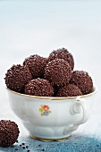 Chocolate truffles in a china cup