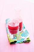 Raspberry juice with ice cubes