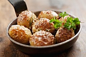Roast potatoes with salt and rosemary fresh from the oven