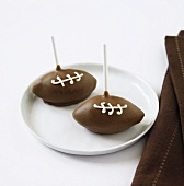 Two Football Cake Pops on a Plate