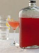 Elderflower Cocktail Mix in a Glass Jar with an Elderflower Martini