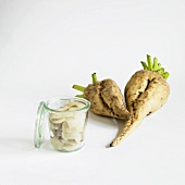 Small Jar of Cooked Sugar Beets with Fresh Sugar Beets