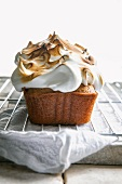 A cake baked in a loaf tin, topped with meringue