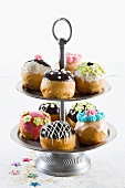 Assorted doughnuts for Hanukkah on a tiered cake stand