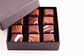 Open box of gourmet caramels