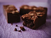 Dark Chocolate Brownies on a Purple Background