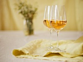 Two Glasses of White Wine on a Yellow Background