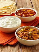 Lime chutney, raita and mango chutney (India)