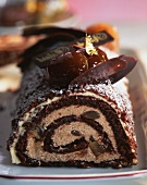 A chocolate roulade with gold leaf for Christmas
