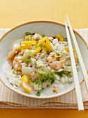A dish of prawns, peppers and chilli with rice
