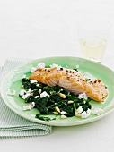 Salmon fillet with spinach, feta and pine nuts