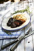 Brasato al barolo (calf's cheeks braised in red wine) with tagliatelle