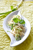 Ribbon pasta with spring onions, lime sauce and lemon balm