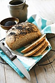 Wholemeal bread with poppy seeds, partly sliced