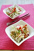 Pasta salad with peppers, cucumber, radishes and mushrooms