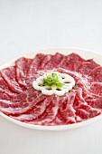 Wagyu beef with lotus root and sliced spring onions