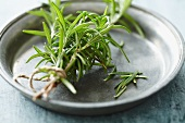 Rosemary sprigs on a tin plate