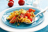 Scrambled egg with tomatoes and ham