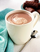 A mug of hot chocolate with chocolate biscuits
