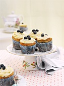 Banana cupcakes topped with blueberries