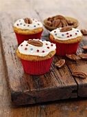 Pecan nut and ginger cupcakes with cranberries