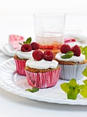 Vanilla cupcakes with raspberries